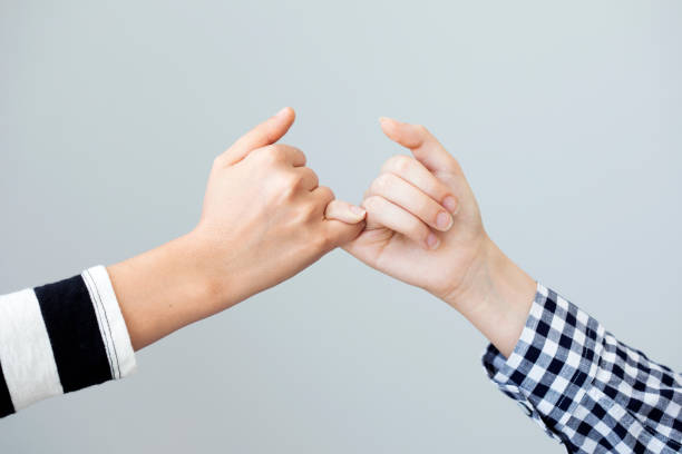 The gesture of the hands mean the promise stock photo