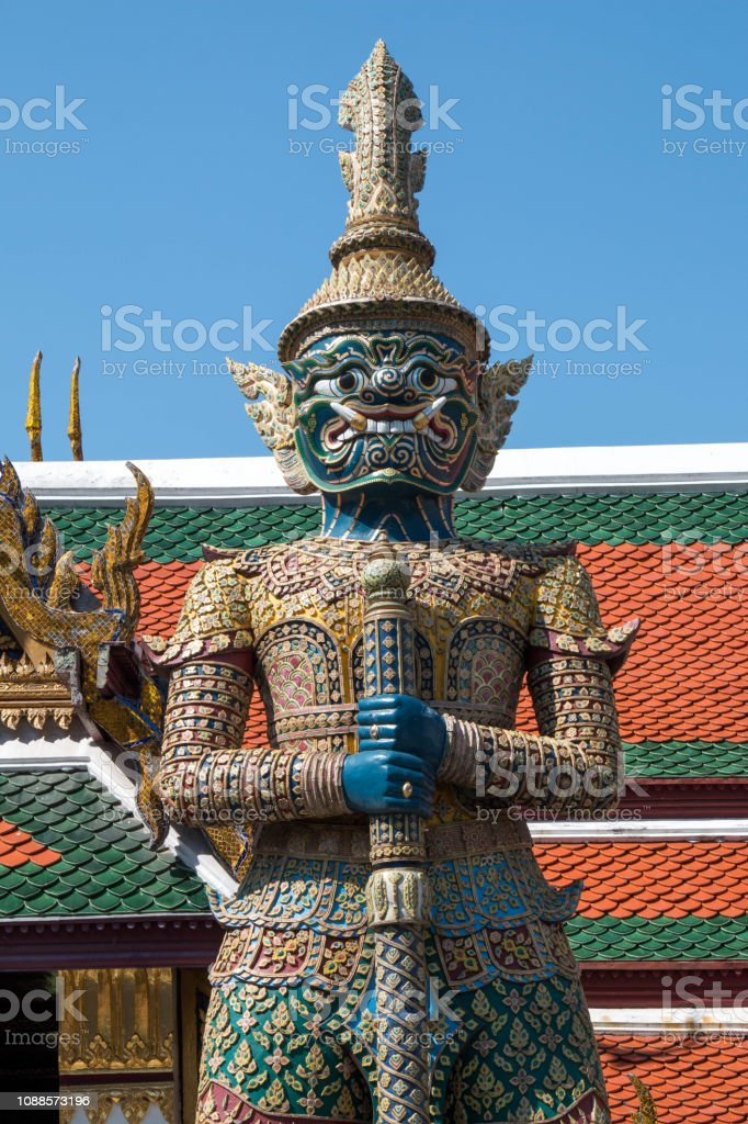 the giant in Temple of the Emerald Buddha (Wat pha kaew) with blue sky. stock photo