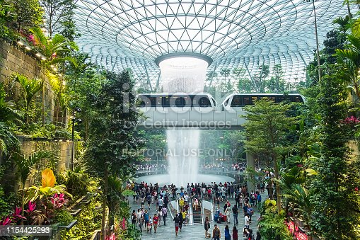 The Giant water fall HSBC Rain Vortex and beautiful green nature Shiseido Forest Valley in the Jewel Changi Airport, link to terminal Changi international Airport in Singapore; Singapore, 11 May 2019