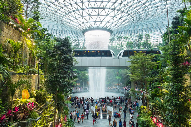 The Giant water fall HSBC Rain Vortex and beautiful green nature Shiseido Forest Valley in the Jewel Changi Airport, link to terminal Changi international Airport in Singapore; Singapore, 11 May 2019 The Giant water fall HSBC Rain Vortex and beautiful green nature Shiseido Forest Valley in the Jewel Changi Airport, link to terminal Changi international Airport in Singapore; Singapore, 11 May 2019 hsbc stock pictures, royalty-free photos & images