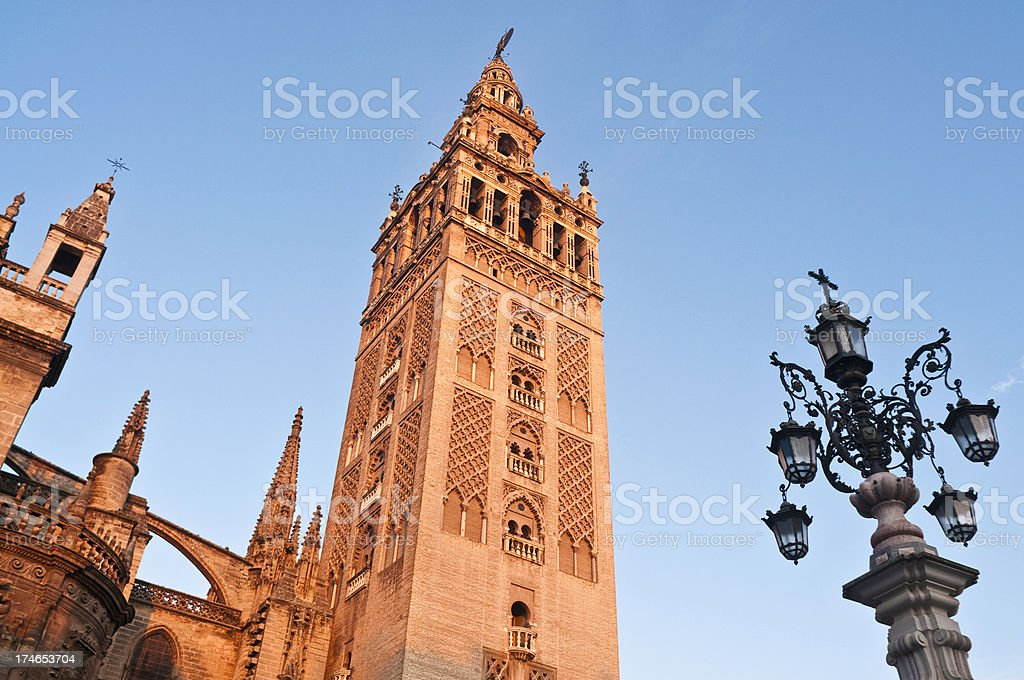 La Giralda Seville Catedral dawn glow stock photo