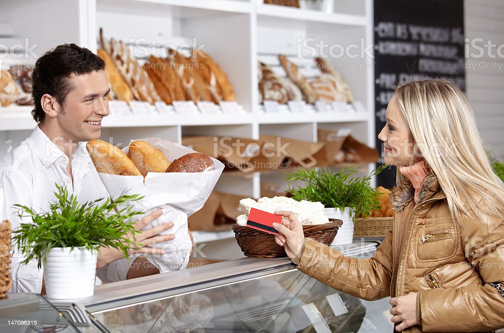 The girl and seller royalty-free stock photo