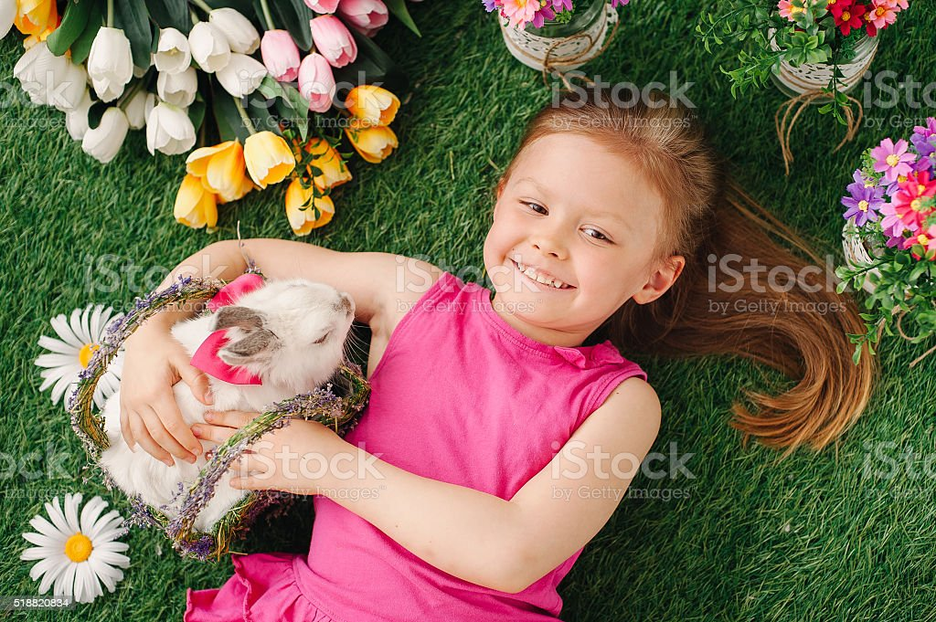The girl and the Easter Bunny stock photo