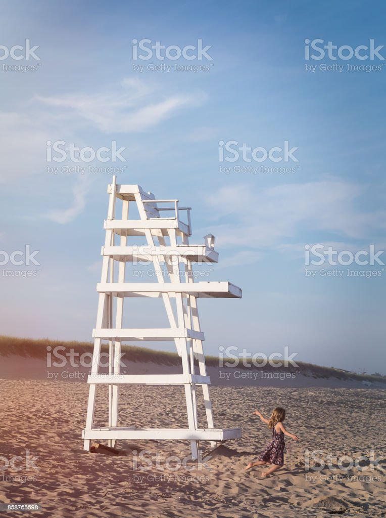 The Girl and the Lifeguard Stand stock photo