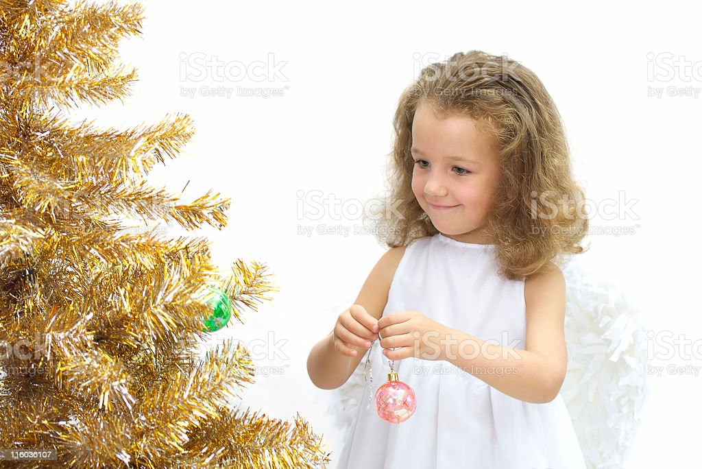 The girl - angel decorating a christmas tree royalty-free stock photo