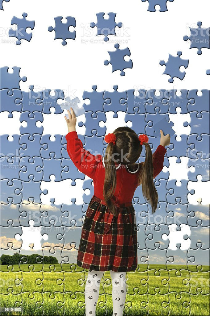 The girl assemble big puzzle royalty-free stock photo
