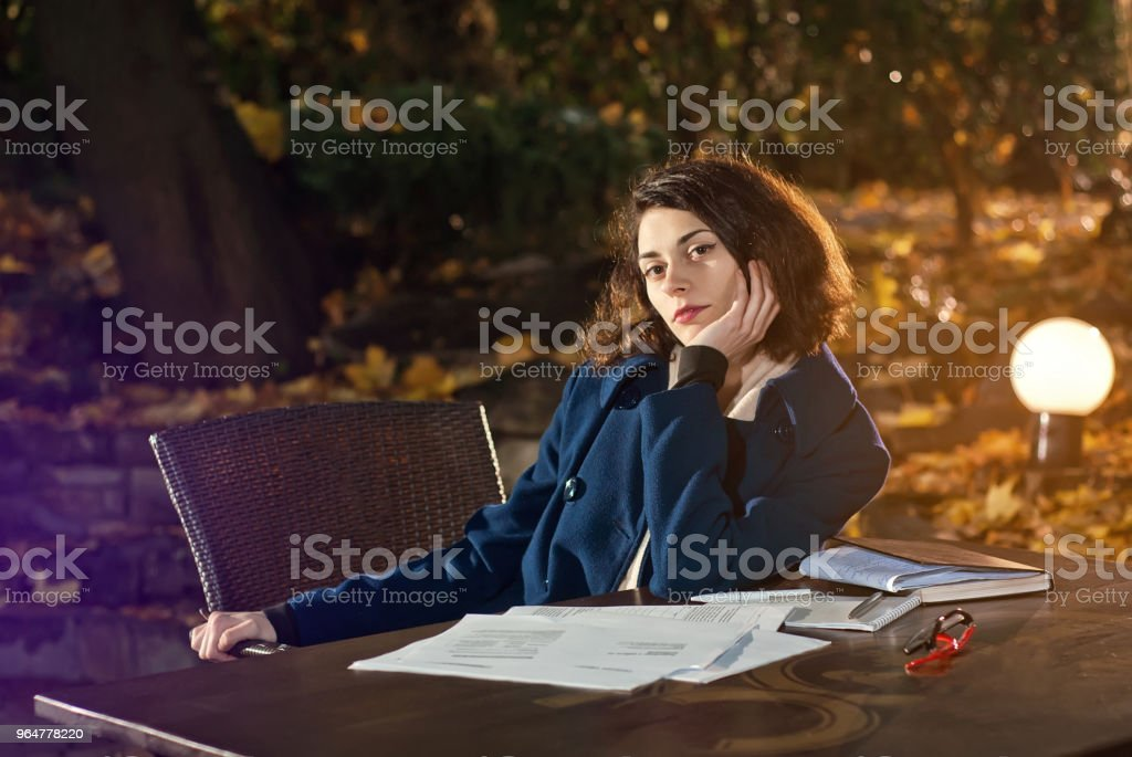 the girl at the cafe at the table royalty-free stock photo