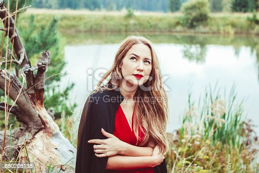 istock the girl at the lake 680208138