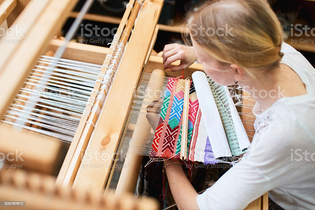The girl at the loom stock photo