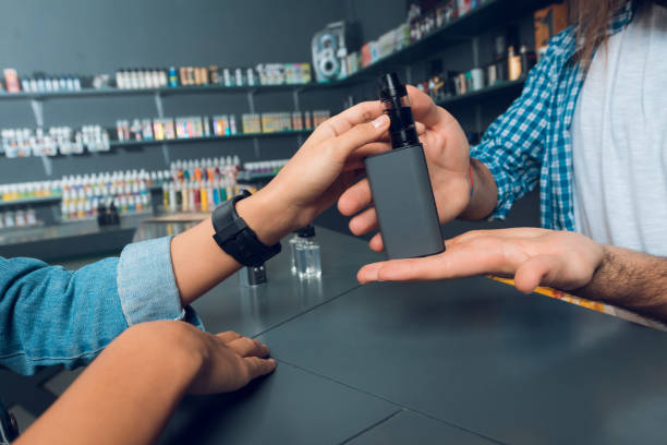 The girl came to the vapeshop. stock photo