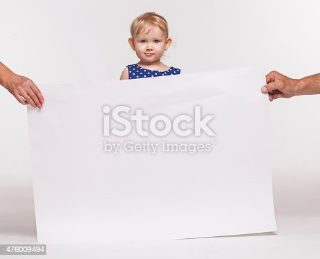 istock The girl child with a large poster 476009494