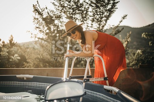 The girl cleans the pool