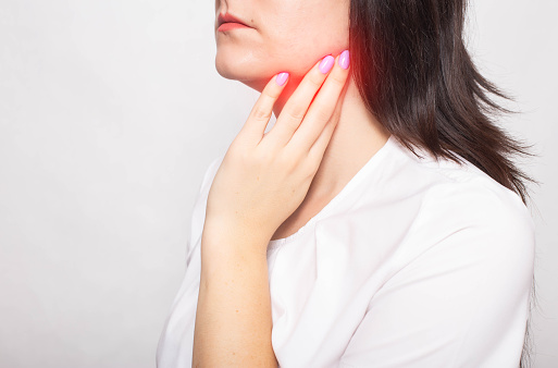 The Girl Clings To The Inflamed Salivary Gland In Which Pain Concept Of Salivary Gland Disease Mumps Cancer Copy Space Stock Photo - Download Image Now