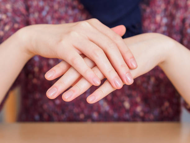 The girl crossed the beautiful hands, tenderness and sensuality, skin care concept. stock photo