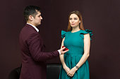 istock The girl did not like the man and his wedding ring. 1134691562