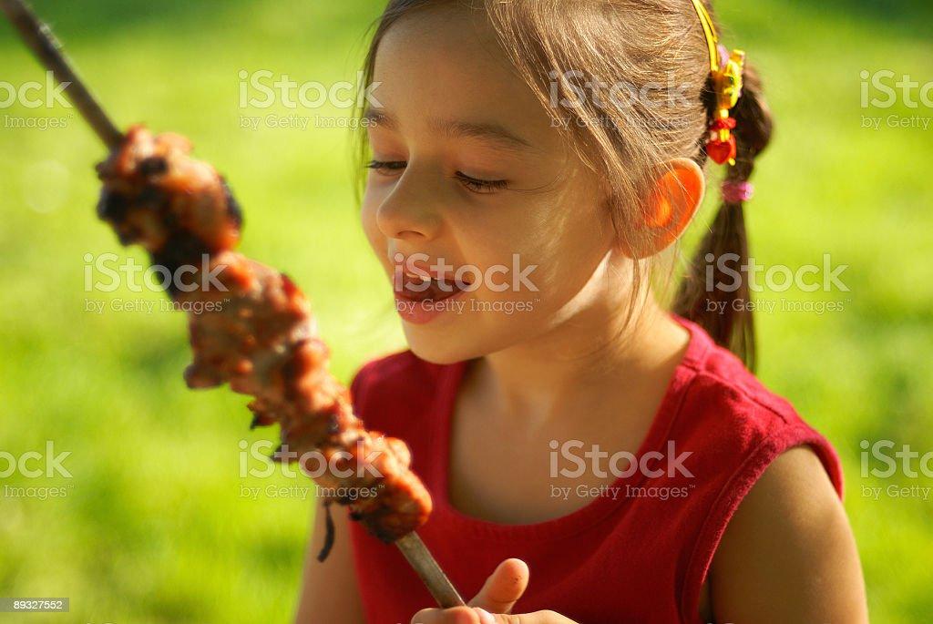 The girl eats a  kebab royalty-free stock photo