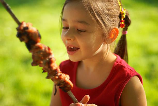 The girl eats a  kebab stock photo