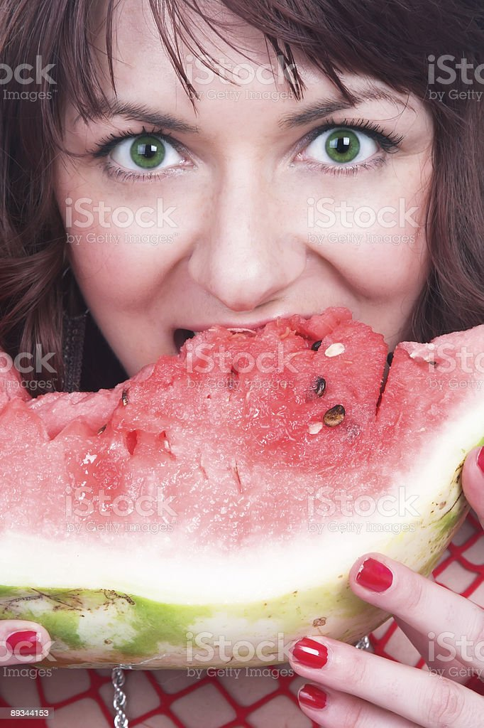 The girl eats a water-melon royalty-free stock photo