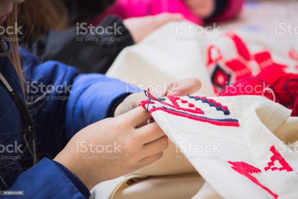 The girl embroider traditional ornament stock photo