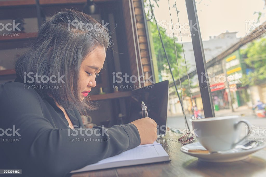 The girl feel happy to begin working-day in peaceful morning stock photo