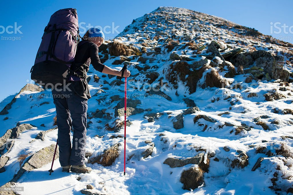 The girl goes through the snow. royalty-free stock photo