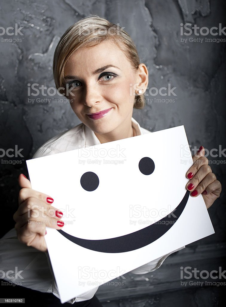 The girl holds a smile royalty-free stock photo