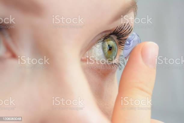 The girl holds on her finger and puts on a soft contact lens for or picture id1206083048?b=1&k=6&m=1206083048&s=612x612&h=1yzscvl0mg6dypltqu6zhkg6bflsi2 ygfafckhdnua=