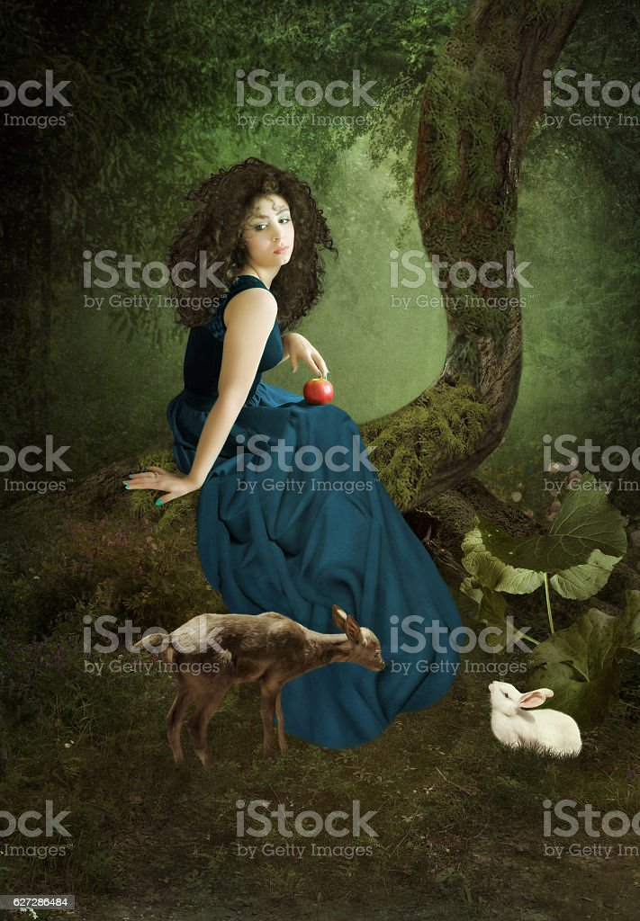 The girl in a forest - Photo