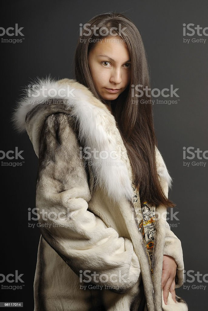 The girl in a fur coat 1 royalty-free stock photo