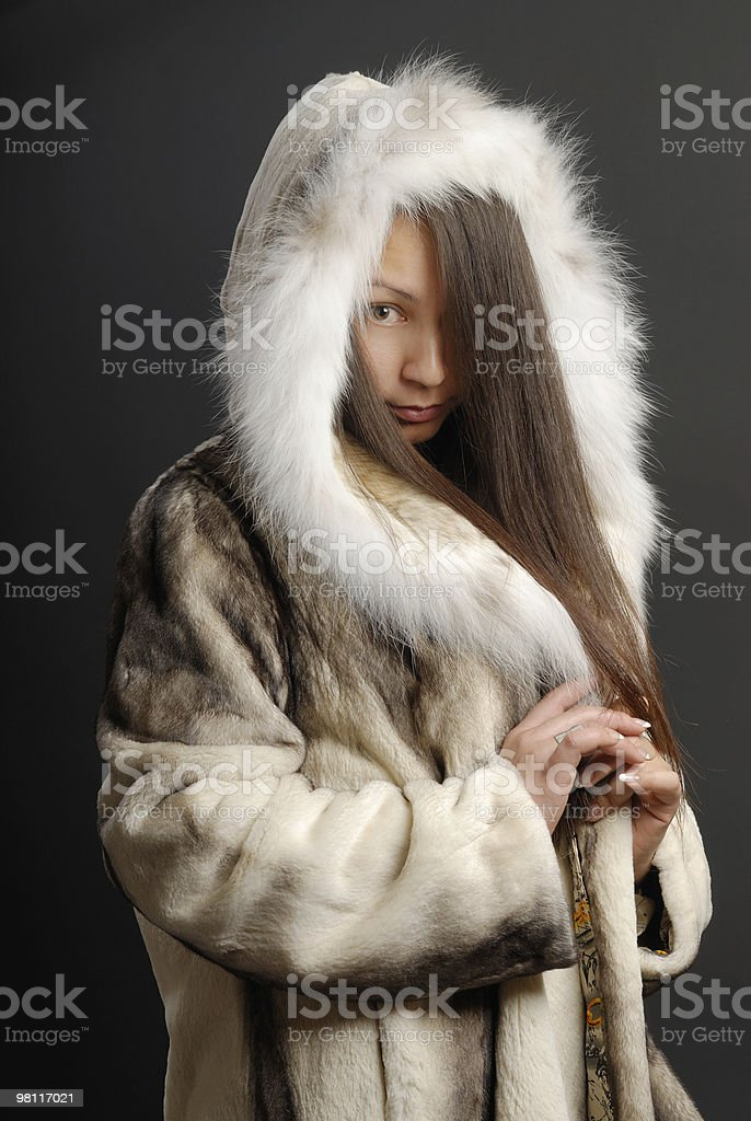 The girl in a fur coat 4 royalty-free stock photo