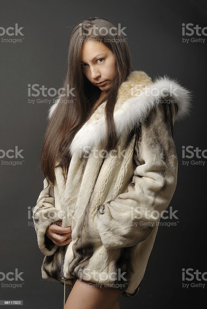 The girl in a fur coat 5 royalty-free stock photo