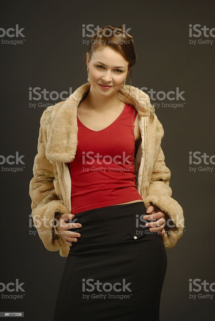 The girl in a fur coat royalty-free stock photo