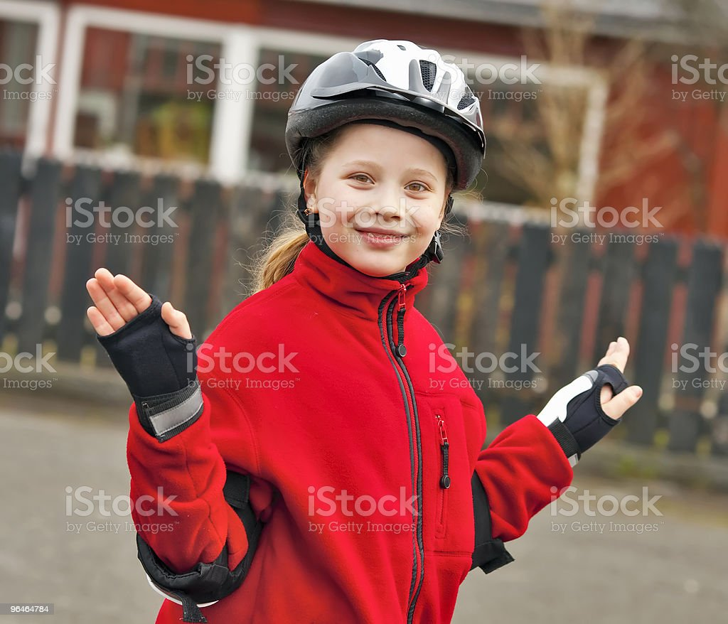 The girl in a helmet smiles royalty-free stock photo