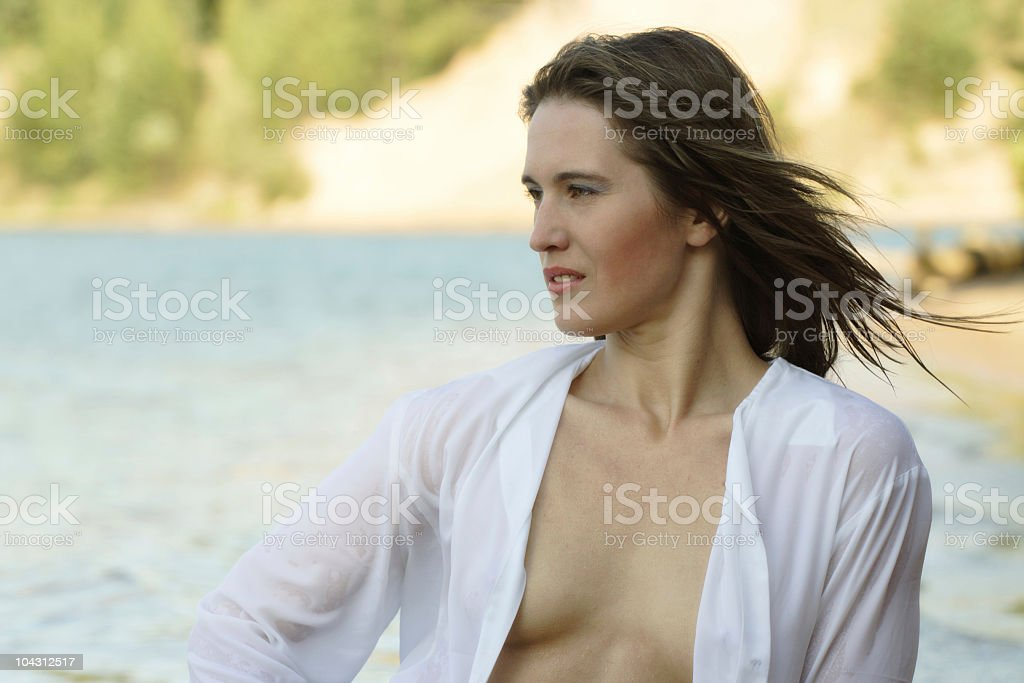 The girl in a wet shirt royalty-free stock photo