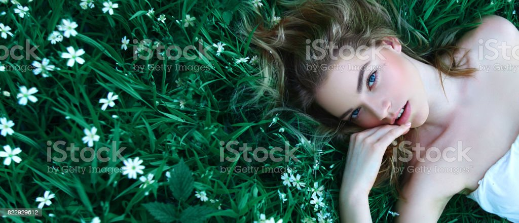 The girl in flowers. stock photo