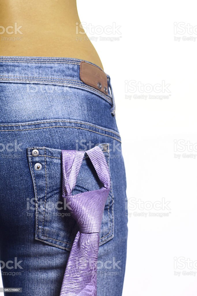 The girl in jeans with fastened tie royalty-free stock photo