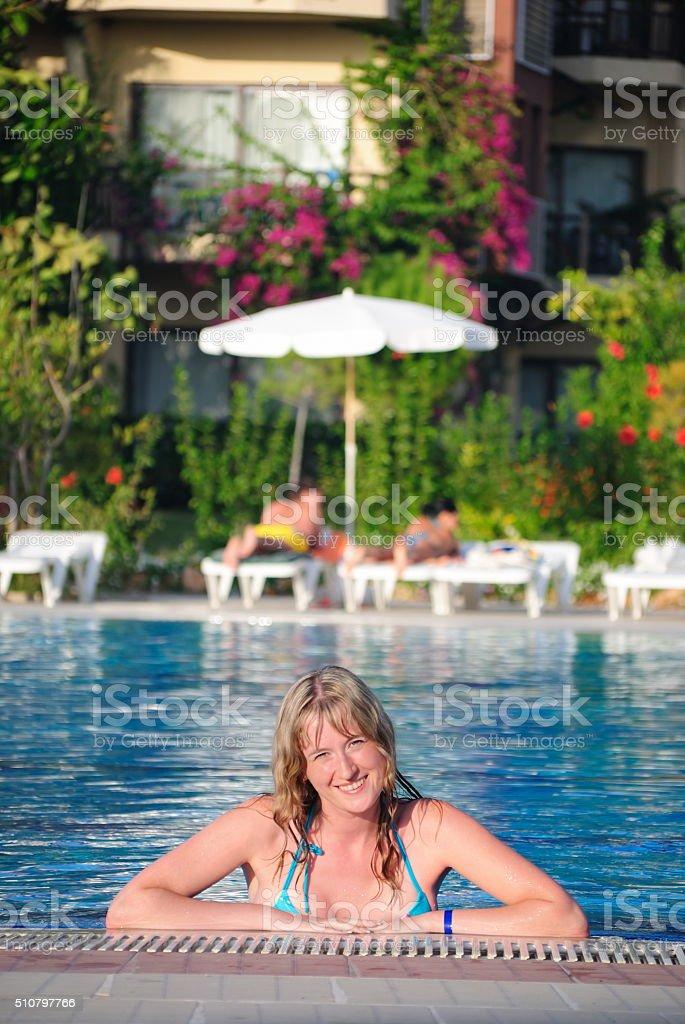 The girl in pool stock photo