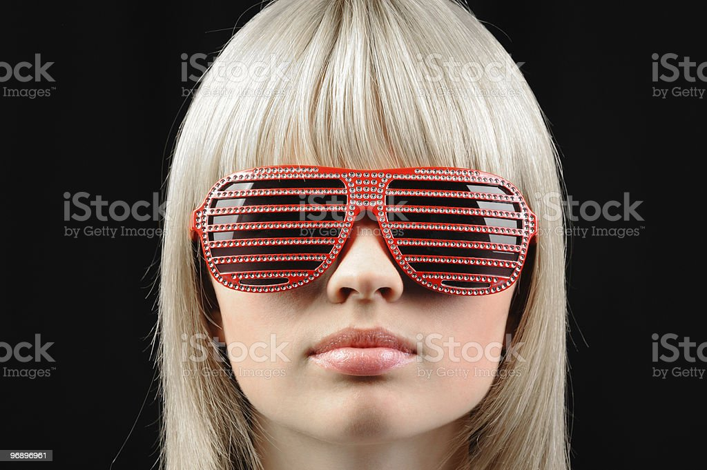 The girl in stylish sunglasses - jalousie royalty-free stock photo