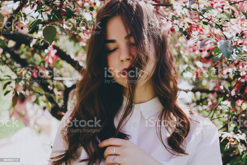 The girl in the blossoming trees. stock photo