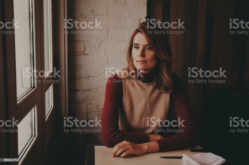 The girl in the cafe. stock photo