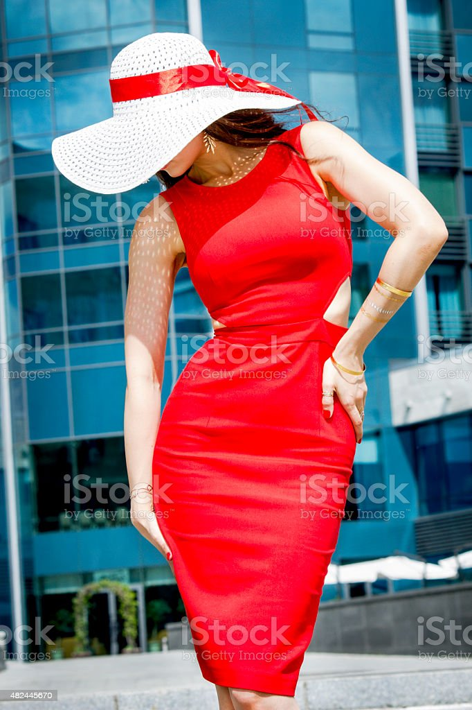 The girl in the red dress stock photo