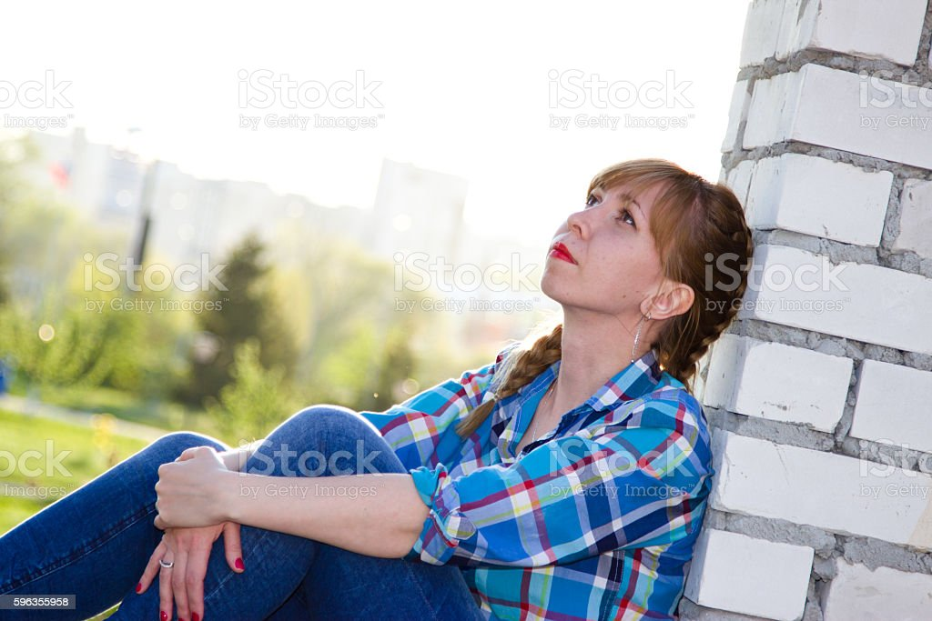 The girl in the window of an abandoned building royalty-free stock photo