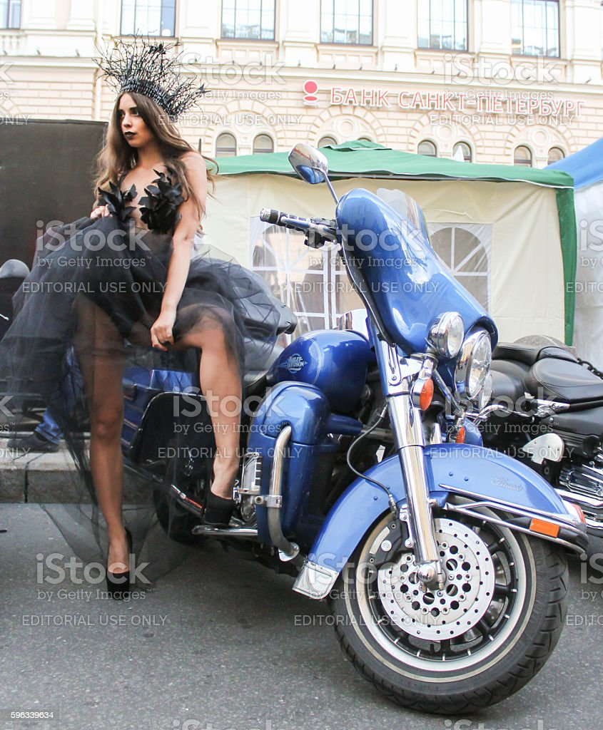The girl in transparent dress posing in blue motorcycle. royalty-free stock photo