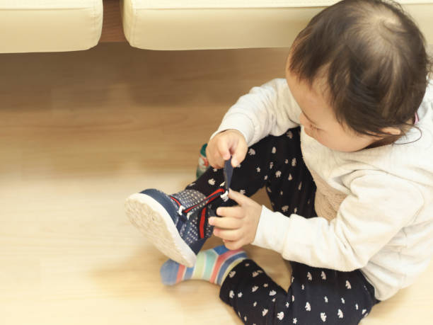 The girl is about to wear shoes stock photo