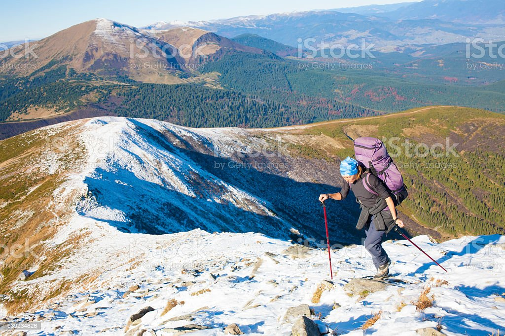 The girl is engaged Hiking in the mountains. royalty-free stock photo