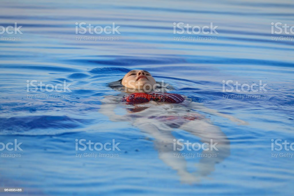the girl is floating under the water royalty-free stock photo