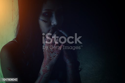 istock The girl is frightened by the evil that is attacking her. 1047606042