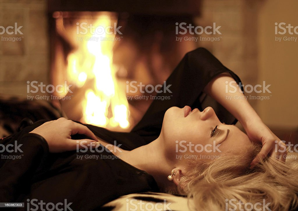 The girl is heated at a fireplace royalty-free stock photo