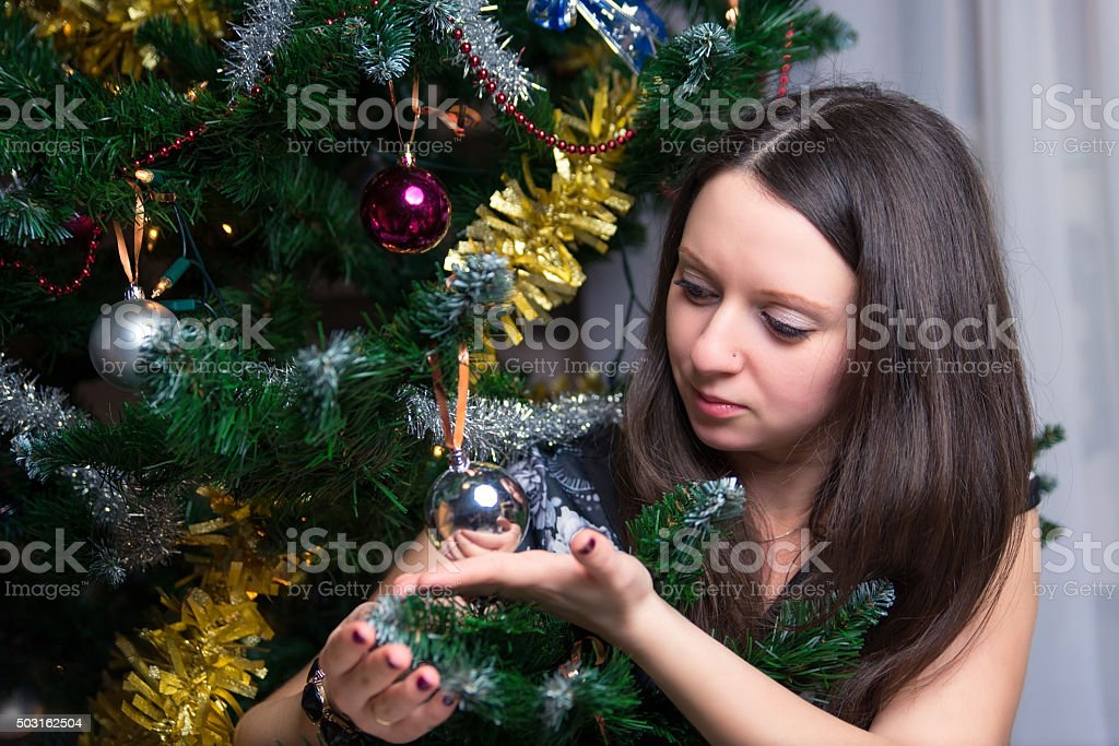 The girl is holding a Christmas tree ball stock photo