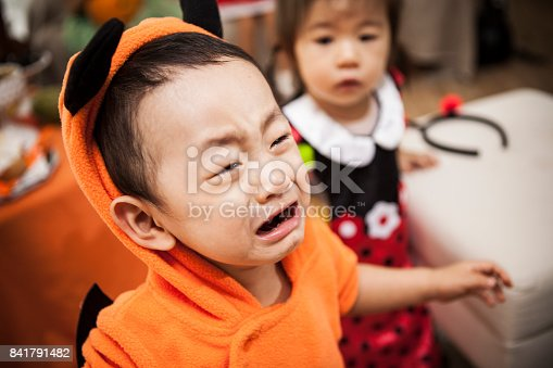 istock The girl is looking at the boy who is crying with anxious expression. 841791482